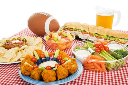 Table spread with appetizer trays for the super bowl 2013 football party.