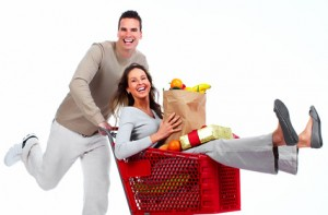 Couple having a LOT of fun grocery shopping