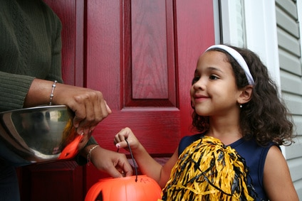 A girl dressed up to go trick or treating
