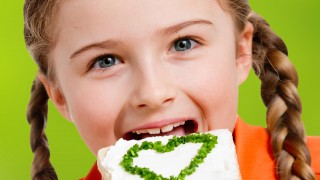 Lovely girl eating healthy sandwich